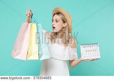 Shocked Young Woman In White Dress Hat Hold Periods Calendar For Checking Menstruation Days Package