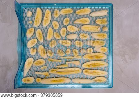 Banana Slices On A Tray Ready For Dehydration Process - Top View