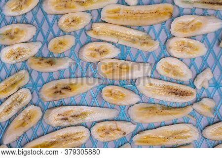 Slices Of Banana On Dehydrator Tray Before Drying.