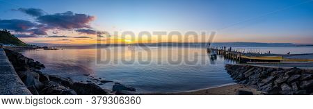 Wide Panorama Of Frankston Foreshore And Boat Jetty At Sunset In Melbourne, Australia