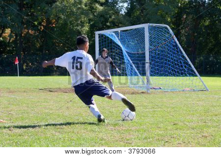 Soccer Player Against Goalie