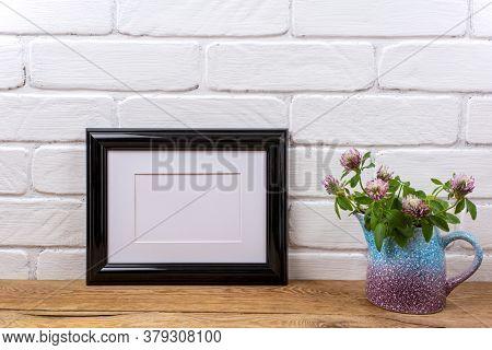 Black Landscape Frame Mockup With Pink Clover