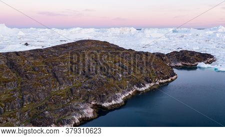 Arctic landscape nature with icebergs and ice in Greenland icefjord. Aerial drone image of ice and iceberg. Ilulissat Icefjord with icebergs from Jakobshavn Glacier aka Sermeq Kujalleq glacier