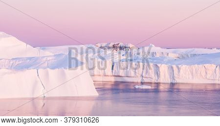Climate Change. Iceberg and ice from glacier in arctic nature landscape on Greenland. Aerial image drone footage of icebergs in Ilulissat icefjord. famously affected by and global warming.