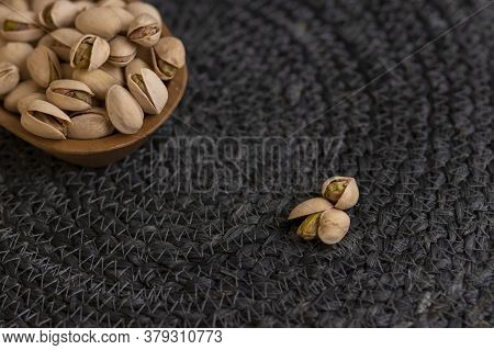 Raw Organic Pistachio Nuts Presented On Wooden Bowl