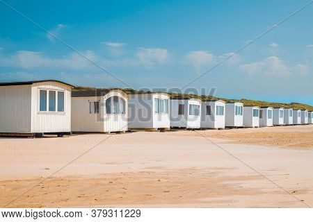 Little Muizenberg Beach Huts; Beach Huts On The Sand With Blue Sky