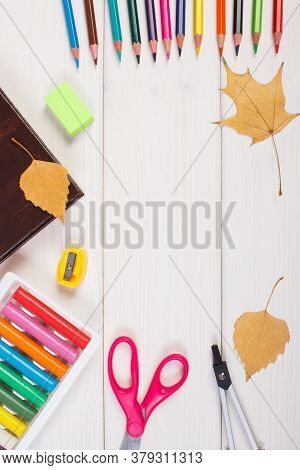 Frame Of Office Accessories, Book And Orange Leaves On Boards, Copy Space For Text Or Inscription, B