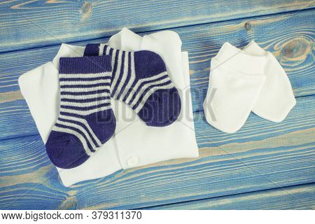 Vintage Photo. Clothes For Little Baby Boy, Extending Family And Expecting For Kids Concept