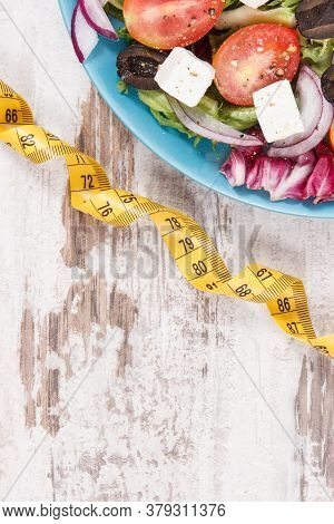 Tape Measure With Fresh Prepared Healthy Greek Salad With Feta Cheese And Vegetables. Best Food For
