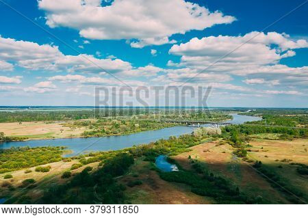 Rechytsa, Gomel Region, Belarus. Aerial View Of Dnieper River. Sunny Sky Above Green Meadow And Rive