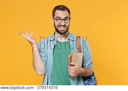 Perplexed Puzzled Young Man Student In Casual Clothes Glasses Backpack Hold Books Isolated On Yellow