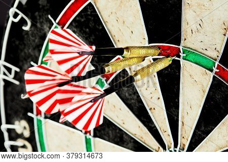 Three Darts Hit Exactly The Three-point Target Area. Business Center Goal Concept.