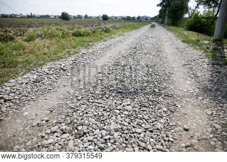 Shallow Depth Of Field (selective Focus) Image With An Unpaved Stone Road.