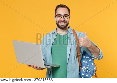 Smiling Young Man Student In Casual Clothes Glasses With Backpack Isolated On Yellow Background Stud