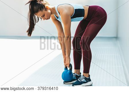 Side View Of Fit Young Woman Lifts A Weight Outdoor On A Sunny Day On White Background. Attractive A
