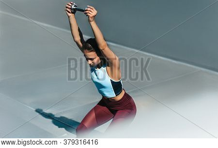 Side View Outdoor Image Of Sporty Young Woman Doing Exercise With Medicine Ball Outdoor On A Sunny D