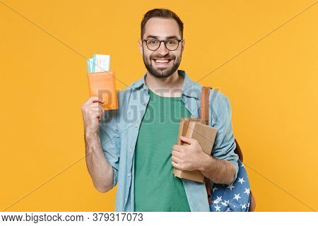 Smiling Young Man Student In Casual Clothes Glasses Backpack Hold Books Passport Boarding Pass Ticke