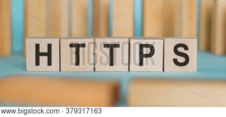 Word Https Formed By Wooden Blocks On A Blue Background