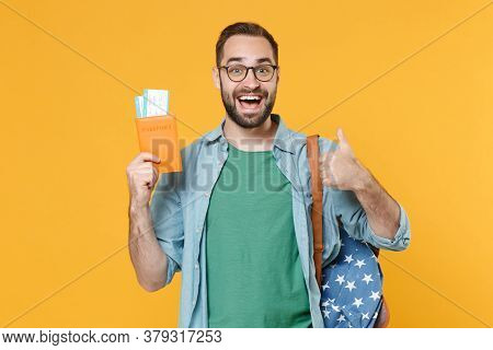 Excited Young Man Student In Glasses Backpack Hold Books Isolated On Yellow Wall Background. Educati