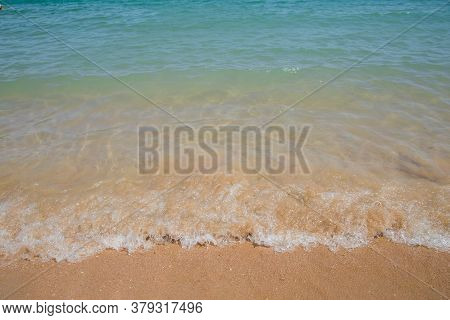 Clear Azure Water On Beach With Sand