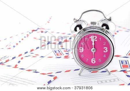 Pile Of Letter Cards And Clock Alarm