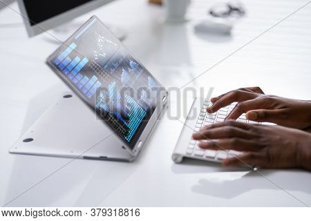 African American Financial Analyst Woman Using Laptop Computer