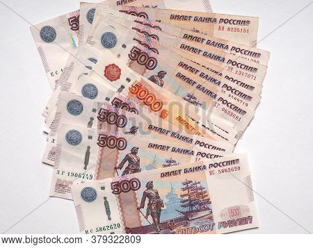 Russian Five Thousand Ruble Bill Peeking Out From A Pile Of Five Hundred Ruble Banknotes
