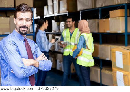 Portrait of White caucasian warehouse owner crossed arm with his worker meeting background in warehouse distribution center environment. Business acquisition and partnership warehouse concept.