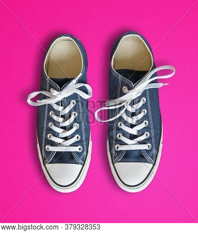 Blue Generic Sneakers Isolated On Pink Background
