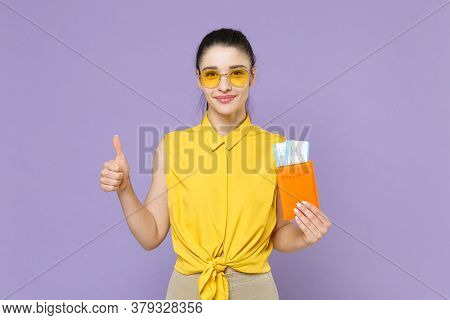Smiling Young Woman Girl In Yellow Shirt Isolated On Violet Background. Passenger Traveling Abroad T