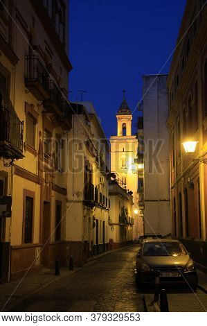 Seville, Spain - July 13, 2011:night Street In The Old Spanish City Of Seville