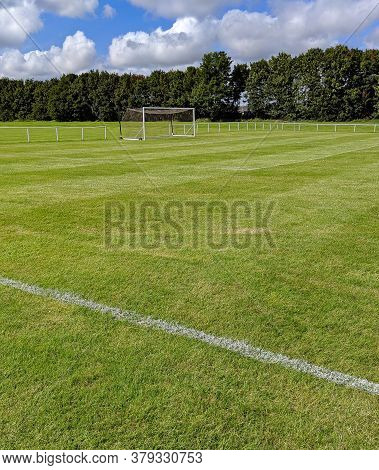 The Goal And Net On A Grass Football Pitch In The Sunshine