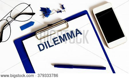 Dilemma Concept With Telephon And Office Tools