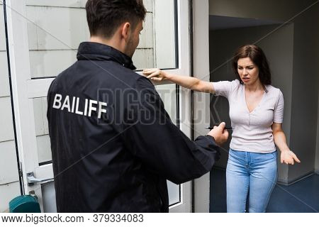 Bailiff Seizure Or Court Arrest Of Young Woman