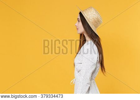 Side View Of Beautiful Young Brunette Woman Girl In White Dress Hat Posing Isolated On Yellow Backgr