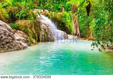 Tropical Landscape With Beautiful Waterfall, Wild Rainforest With Green Foliage And Flowing Water. E