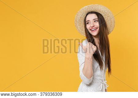 Side Veiw Of Smiling Young Brunette Woman Girl In White Dress Hat Posing Isolated On Yellow Backgrou