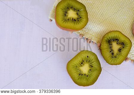 Tropical And Subtropical Kiwi Fruit With A Hard Peel And Sweet Greenish Flesh, Rich In Trace Element