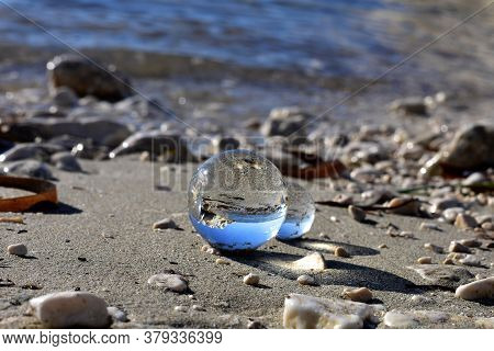 Beautiful Transparent Glass Balls At The Beach Flips The View Upside Down/ Beautiful Landscape Natur