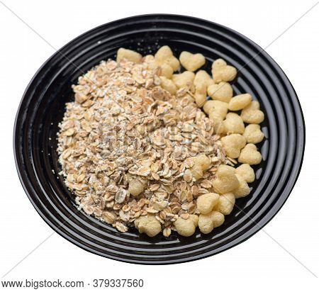 Healthy Breakfast On A Plate Isolated On White Background.muesli With Cornflakes, Raisins, Dates, Pe