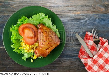 Chicken Wing With Salad, Corn And Tomato On Green Plate With Fork And Knife Top View. Chicken Wing W