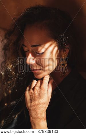 Conceptual Close Up Fashion Portrait Of Beautiful Woman With Curly Hair In Dark Tone. Amazing Warm S