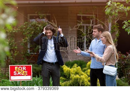 Irritated Real Estate Manager Dealing With Angry Clients In Front Of Residential Property Outside