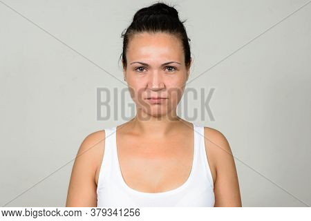 Portrait Of Stressed Woman Against White Background
