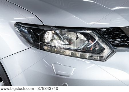 Novosibirsk/ Russia - August 01 2020: Nissan X-trail, Silver Car Headlights. Exterior Detail. Close