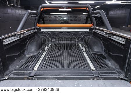 Novosibirsk/ Russia - August 01 2020: Nissan Navara, Rear View Of A Pick Up  With An Open Trunk. Ext