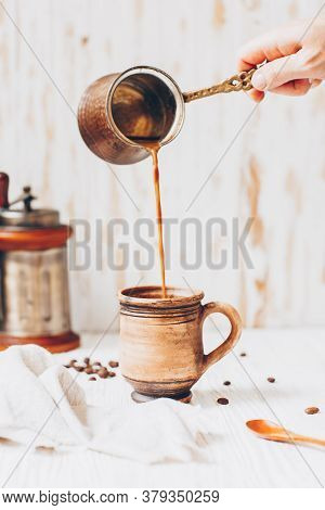 Coffee With Milk On White Wooden Background