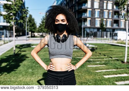 Sport In Safety During Quarantine. Close-up Portrait Of Young Beautiful Multi-ethnic Woman In Sports