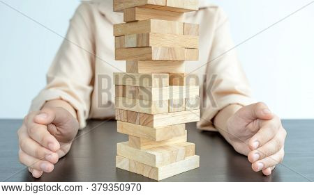Woman Hand Prevent Wood Blocks Game, Concept Risk Of Management And Strategy Plan, Growth Business S