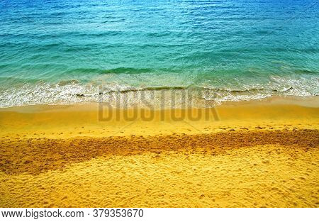 Aerial view of transparent turquoise sea and beach in summer day. Top view